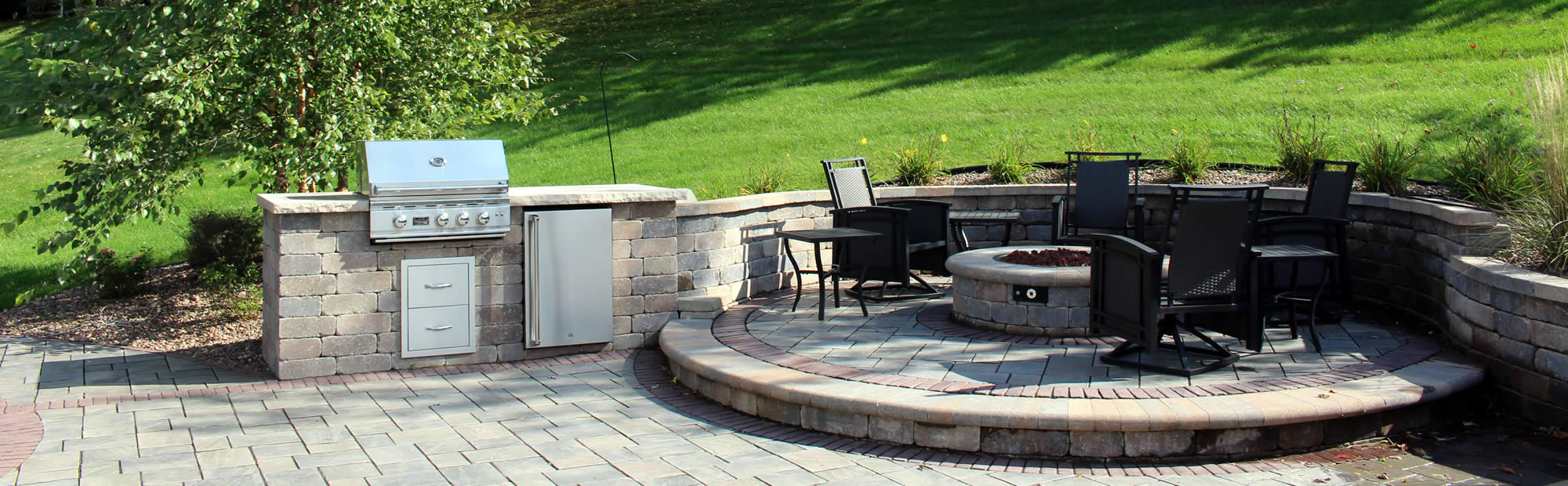 Outdoor Kitchen with Patio and Retaining Wall Construction